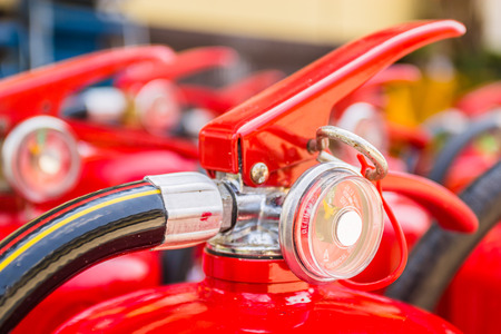fire rescue: Red fire extinguishers available in fire emergencies