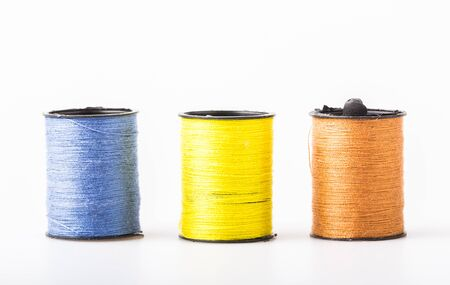 wor: Roll sewing thread colors include brown, yellow and blue.