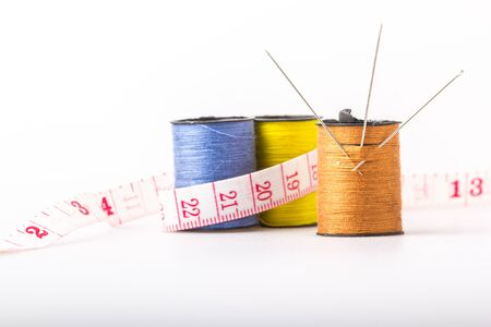sewing threads and tape measure Stock Photo