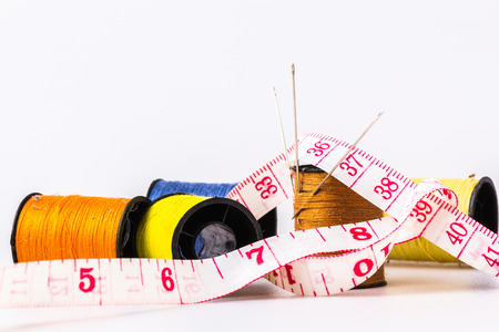 Needles in three of the lace into rolls sewing sewing thread with tape measure wrapped around