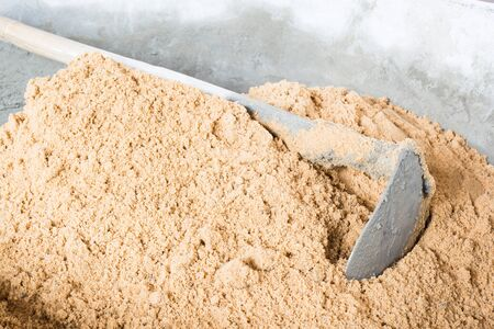 compacted: Pick up a shovel cement concrete mix is compacted sand. Waiting to be mixed with cement Stock Photo