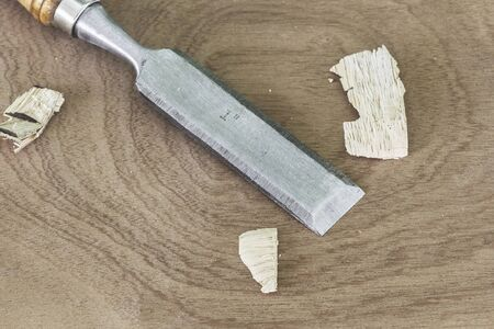carpenter's sawdust: Wood chisel, drill the empty background as a piece of wood. And a sliver of the next drill. Stock Photo
