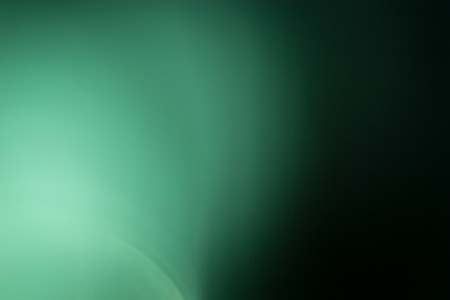 Green background, taken through a green filter in the light toward the sun, adjusting the image to be blurred with the white edges of the image. Stock Photo