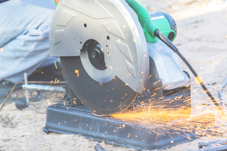 Fiber cutter He was cutting steel bars with the light of a scrap of iron. Stock Photo