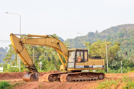 A big excavator earthmoving works on  construction site in Phuket Thailand