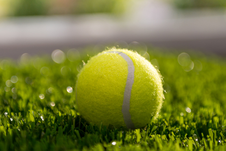 A Tennis on artificial turf under sunlight Stock Photo