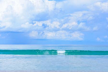 Beautiful blue sky, beauty wave and white sand on Kata beach Phuket Thailand.