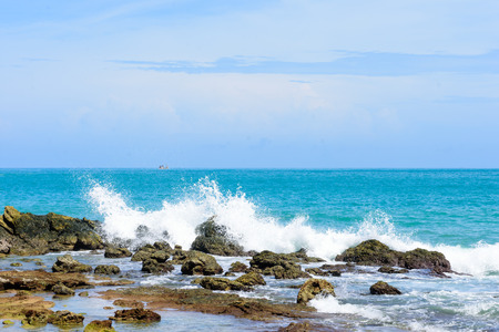 Beautiful wave on the stone, clear water at andaman sea Phuket Thailand.