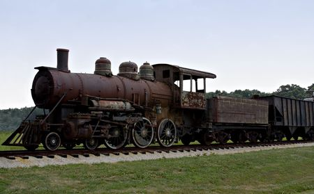 coal fired: An old rusted coal fired steam locomotive