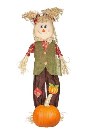 Autumn doll with pumpkin isolated on white photo