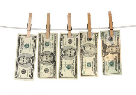 Dirty money hanging from a clothsline isolated on white