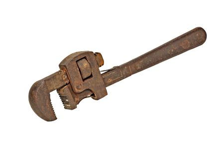 Rusty pipe wrench isolated on a white background photo