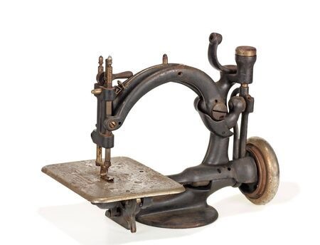 machines: Old rusted sewing machine on white background Stock Photo