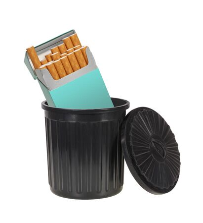 Pack of cigarettes thrown away in a garbage can isolated on white Stock Photo - 4484110
