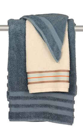Bath towels and washcloth hanging on towel bar isolated on white