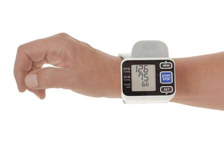 Wrist blood pressure monitor showing normal blood pressure isolated on white photo