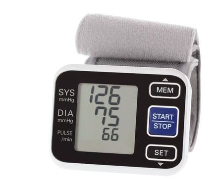 Wrist blood pressure monitor showing normal blood pressure isolated on white Stock Photo