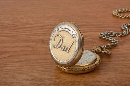 time of the day: Dads pocket watch for fathers day on a wood desk top Stock Photo