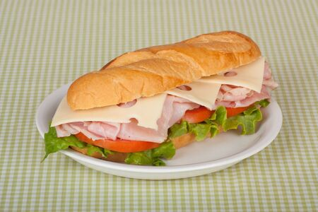 Ham and swiss cheese sub sandwich with lettuce and tomato on a bun Stock Photo - 7337834