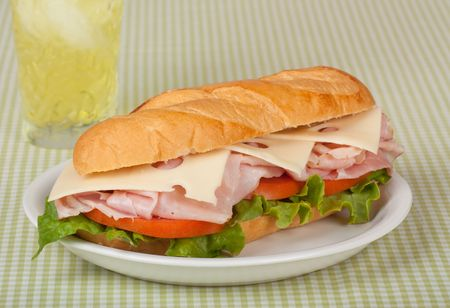 Ham and swiss cheese sub sandwich with lettuce and tomato on a bun with a drink Stock Photo - 7365244