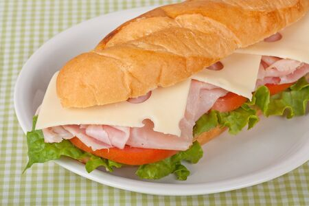 Ham and swiss cheese sub sandwich with lettuce and tomato