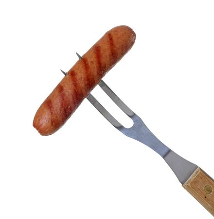 wiener: Grilled hotdog on a barbecue fork isolated on white Stock Photo