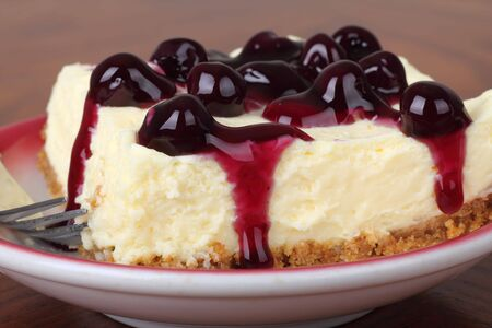 Cheesecake topped with blueberries on a plate Stock Photo