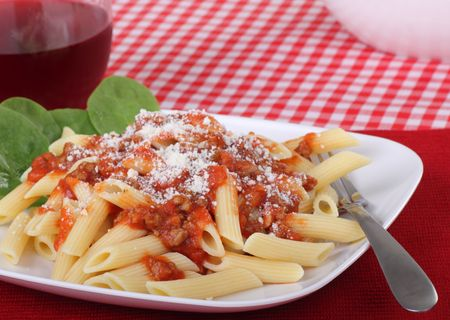 penne pasta: Penne pasta topped with tomato meat sauce and parmeson cheese