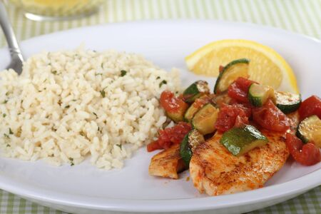 Tilapia fish fillets covered with zucchini and tomato with rice Stock Photo - 7897537