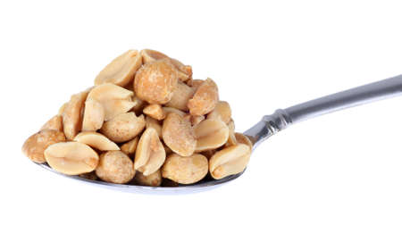 heaping: Heaping pile of peanuts on a spoon isolated on white