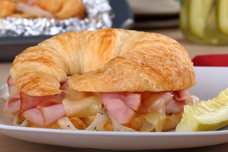 Ham and cheese with onions on a croissant bun Stock Photo - 8157319