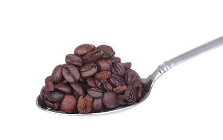 heaping: Heaping spoonful of coffee beans isolated on white