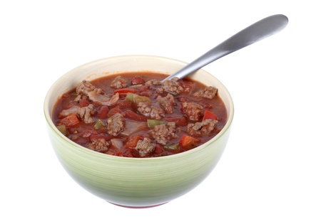 Bowl of chili soup isolated on white