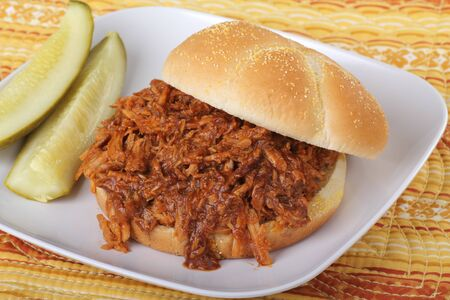 barbecue pork barbecue: Pulled pork barbeque sandwich with pickles on a plate Stock Photo