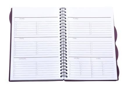 Geopende Weekplanner geïsoleerd op een witte achtergrond