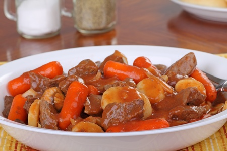 beef stew: Plate of beef stew with carrots and potatoes Stock Photo
