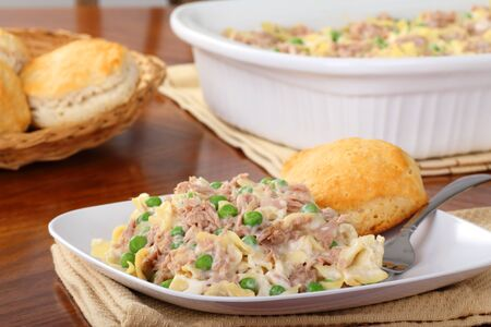 Tuna casserole with a biscuit on a plate