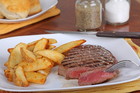 a rare: Slice of rare steak with potatoes on a plate