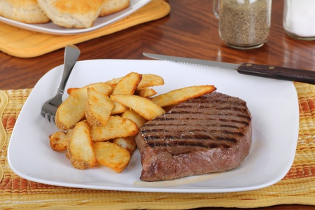 Grilled steak with potatoes on a plate Reklamní fotografie