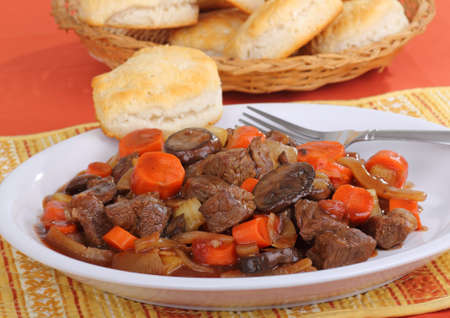 beef stew: Beef stew with carrots and mushrooms and biscuits