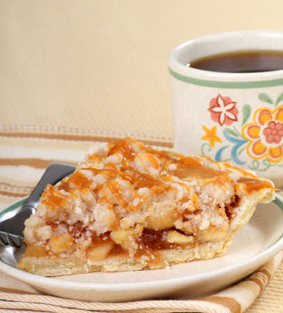 Apple pie topped with caramel and a cup of coffee Stock Photo