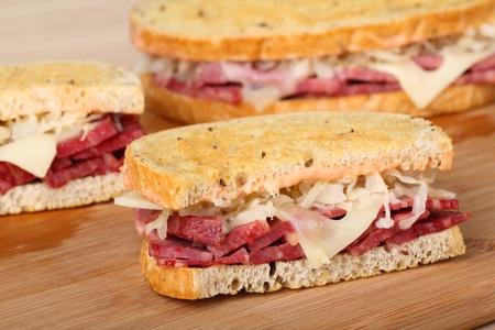 reuben: Sliced reuben sandwich with corned beef, sauerkraut and swiss cheese Stock Photo