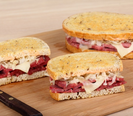 reuben: Corned beef sandwich with cheese and sauerkraut on toasted bread