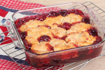 Cherry cobbler dessert on a cooling rack
