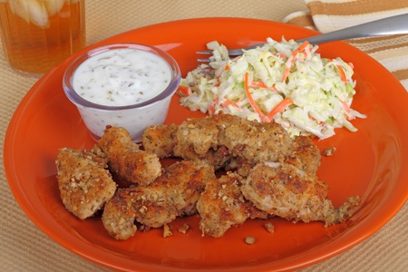Chicken strip meal with dipping sauce and coleslaw