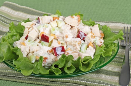 Chicken salad with apple pieces on top of lettuce Фото со стока