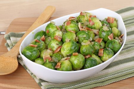 Serving bowl of brussels sprouts with bacon pieces on top