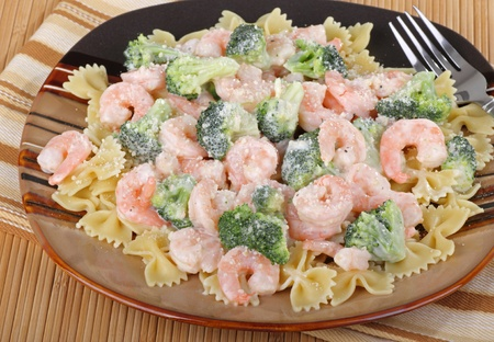 florets: Shrimp and broccoli florets on top of pasta