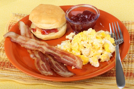 Bacon and scrambled egg breakfast with a biscuit Stock Photo - 9170730