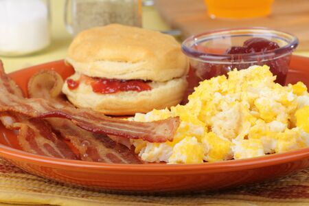 Bacon and scrambled egg breakfast with a biscuit photo
